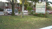 Lawn and sign outside Walnut Garden Apartment complex
