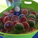 Basket of Jell-O shots with a bottle of pinnacle whip vodka