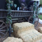 Hay bales leading up to a wagon